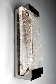 ALEX SCONCE: polished facted cast crystal with handmade metalwork