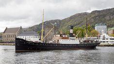 "1913 built steam ship ""Stord 1"" in Bergen with Bergenhus fortress in the background. JoachimKohlerBremen - Own work"