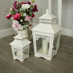 Set of 2 Vintage Cream Lanterns With pretty embellishing on the metal surround and glass panels Would make a lovely addition to your garden or patio. Perfect for wedding centrepieces A great idea as a house warming gift or birthday present With metal hook for hanging  £23.95 www.melodymaison.co.uk