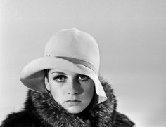 Model Twiggy posing in the studio wearing a hat. December 1966. (Photo by Daily Herald)