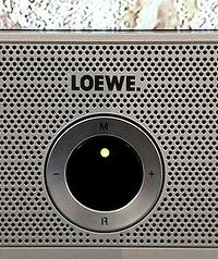 Modern speaker on a  Loewe TV.