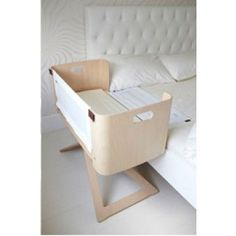 A co-sleeper is a baby bed that attaches to one side of an adult bed. It allows baby to remain close to the parents at night without actually being in the adult bed (which can be dangerous sometime… Baby Co Sleeper, Bedside Crib Co Sleeper, Baby Kind, Nursery Inspiration, Baby Decor, Kids Furniture, Modern Baby Furniture, Modern Baby Cribs, Furniture Plans