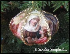 BRILLIANT idea to make Saint ornaments throughout the year for their Feast days...and then display them at Christmas for a Catholic Christmas tree...from Sanctus Simplicitus