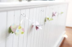 Another adorable and unique paper garland idea. The circles make it modern!