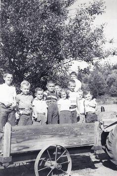 children in a farm wagon - 1950s