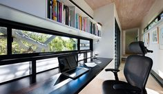 Interior Design Idea - 13 Examples Of Desks In Hallways // A long desk running the length of the window provides an excellent space to study or work from and has a nice view to help keep you inspired.