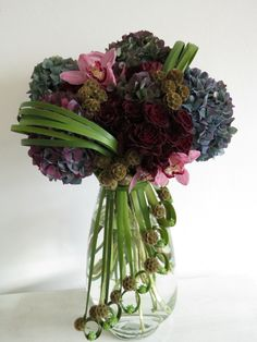 Floral Art ~ blue hydrangeas, cymbidium orchids, deep red roses and scabiosa pods