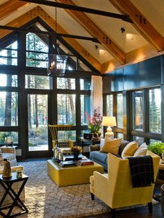 With soaring ceilings, unexpected bursts of bright colors and soft, cozy textures, this living room blends everything there is to love about modern mountain living.
