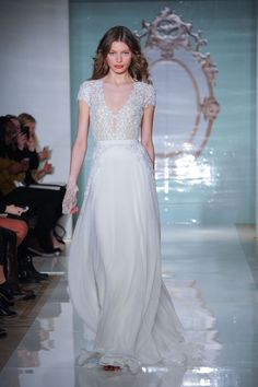 This lace short-sleeve V-neck gown is sexy yet conservative. From the Reem Acra spring 2015 bridal collection.