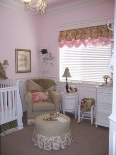 pink baby nursery. Chandelier, plaid glider rocker, pink paint.