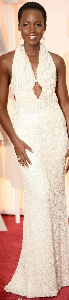 Lupita Nyong'o in an artful, pearl-embellished custom gown by Franciso Costa for Calvin Klein Collection. 2015 Oscar Red Carpet