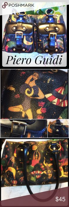 Designer Piero Guidi Magic Circus Handbag Piero Guidi has its origins in Tuscany Italy in 1896. Since then they have evolved in elegant Italian design but refuse to mass produce respecting the relation between object and agent. Luxury Italian made Handbag with leather pockets, trim and strap. This handbag is a roomy sassy designer bag in very good condition. The lining inside is a bit worn but no external signs of wear. Enjoy this unique and beautiful designer piece at a fabulous price…