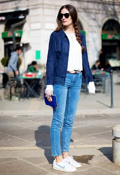 Navy suede fringe jacket with light-wash jeans and Nike sneakers