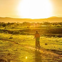 """I just love this picture. """"Into the sun"""" in Tanzania.  I was watching the sunset and he rode right into the frame and I started snapping away."""