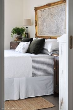 Beautiful DIY master bedroom on a budget with gorgeous framed map headboard