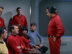 """""""Where is Captain Kirk?!"""" demands Scotty, quite un-cowed.  Left to right, Leiutenant Singh, Scotty, Lieutenant Uhura, Doctor McCoy.  Behind are Kahn's henchmen. In front is Kahn ~ Space Seed"""