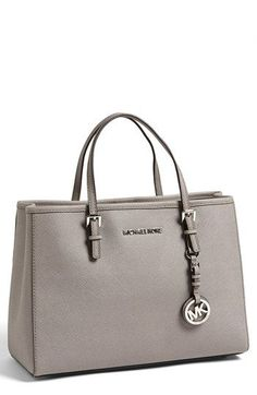 Free shipping and returns on MICHAEL Michael Kors 'Jet Set' East/West Saffiano Leather Tote at Nordstrom.com. Polished logo hardware and buckle details provide a refined finish for an essential tote crafted from lustrous Saffiano leather.
