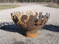 Custom firebowl with nature motifs of Squirrel Fern Pine