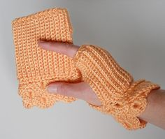 The Crocodile Stitch pattern on these beautiful handwarmers adds a feminine touch. These fingerless gloves are very warm, soft and cozy. They can