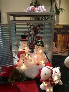 Snow family in large resort lantern ~ Adorable.   Get yours today.  Contact me to get the lantern half off with your snow family purchase.