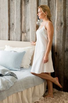 Light weight and soft linen nightgown with straps and a small lace edge. Make yourself enjoy sleeping even more than usual!  Handmade in Latvia from softened 100% organic linen.  DESCRIPTION: -High quality 100% linen (flax); -Color: white; -Light weight; -Softened; -Stonewashed; -No need to iron.  Model is 168 cm ( 56) tall and wears size S (US 2-6).  CARE INSTRUCTION: -Gentle wash cycle (40°C) -If you feel like ironing (although should not be necessary), do it with steam or while the dress…