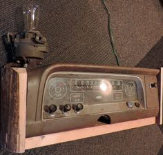 Car Parts LAmp, Dash cut from a circa 1965 Chevrolet C10 with original instrument cluster. Carburetor is from the same truck. Box is barn wood scraps. Has new dimmer, cover, Edison bulb, and re-used socket.