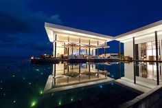 A starry, starry night-lit pool at Jumeirah Dhevanafushi, one of the best resorts in the Maldives.
