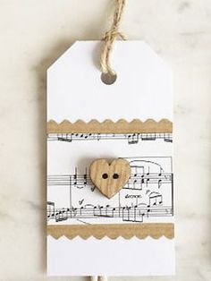 49 Ideas For Craft Paper Wrapping Christmas Sheet Music Christmas Gift Tags, Christmas Wrapping, Christmas Tags Handmade, Christmas Christmas, Holiday Gifts, Paper Tags, Paper Gifts, Kraft Paper, Christmas Sheet Music