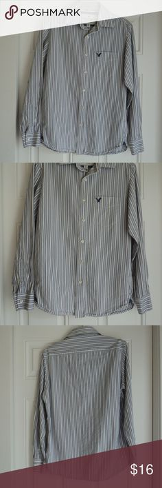 """American Eagle Men's Dress Shirt Small American Eagle Vintage Fit Button Down Dress Shirt. Size Small. Blue/green/white stripes. White buttons with American Eagle embossing.   Condition:   Gently used.  Material:    100% Cotton Underarm to Underarm across the front:   20""""  Top of shoulder to bottom edge:   28""""  Sleeve length:   25"""" Pet free and smoke free home. American Eagle Outfitters Shirts Dress Shirts"""