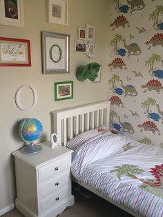 Dinosaur room - Laura Ashley wallpaper and bedding. Dulux Jurassic paint and pointing by farrow and ball - dinosaur picture wall - dinosaur boys room - The White Company single bed