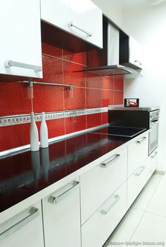 #Kitchen Idea of the Day: Modern white kitchen with a red backsplash.