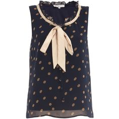 Sleeveless spot print pussybow top with buttons on the front and frill collar.Length 56cm. 100% Polyester. Machine washable.