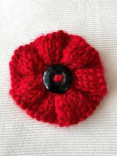 This poppy pattern is a blend of a few different patterns used for the Great Lakes 5000 Poppies Project. While knitting your own re-usable poppy can be both meaningful and sustainable, it is important Knitted Poppy Free Pattern, Knitted Flowers Free, Knitted Poppies, Knitted Flower Pattern, Poppy Pattern, Crochet Flowers, Flower Patterns, Knitting Stitches, Knitting Patterns Free