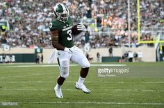 News Photo : Lj Scott of the Michigan State Spartans rushes...