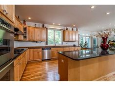 Example of light hardwoods and cabinets with DARK granite