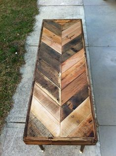 reclaimed herringbone pallet table. just beautiful. Cross this idea with the original basement table and the pipes for the legs. Yes.