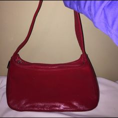 Used authentic Perlina red small purse Used. Has slight dark marking from wear on four corners. Real leather inside (black) and out. NEGOTIABLE! Perlina Bags