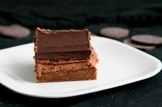 noir bars - I may have to make these. Chocolate cookie base + chocolate cream cheese + ganache