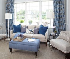 living-room must have white sofa and colored cushions andbig (French) window and sunlight
