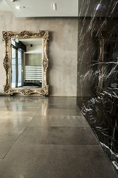 This apartment foyer the epitome of what Melbourne design is - classy, dark and sleek. Our large format Bluestone tiles have been used throughout the entry foyer floors, leaving the Toros Black Marble walls to shine! #glux #architecture #stone #design #interiors