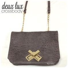"""DEUX LUX cross body purse PRELOVED in good condition. normal wear and tear- nothing noticeable. small zippered pocket inside with a twist lock closure  height- 7"""" length- 10"""" width- 2"""" strap length- 45"""" from end to end, 22"""" drop (adjustable)  please don't hesitate to ask questions. happy POSHing    use offer feature to negotiate price on single item  i do not take any transactions off poshmark, so please do not ask. Deux Lux Bags Crossbody Bags"""