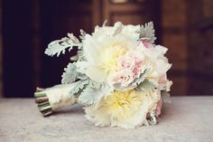 dahlia, miniature roses and dusty miller.