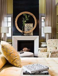 Dramatic fireplace wall made of riveted metal. Featured in Traditional Home.
