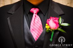 Groom's attire for the wedding--- minus the flower... I don't like that at all. WOuld pick a different type of flower