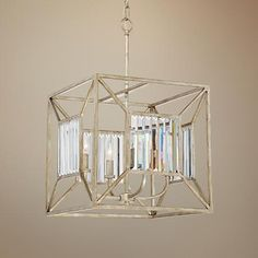 This transitional square cage chandelier features rich vintage gold finish and accent panels of elegant beveled glass.