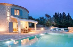 Book The Round House with Simpson Travel; situated in Paxos, Greece, this is a perfect holiday retreat. Greece Holiday, Round House, House 2, Arrow Keys, Close Image, Villa, Mansions, Bedroom, House Styles