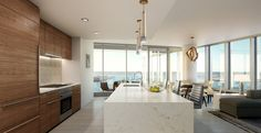In the summer, New York City-based firm Kohn Pedersen Fox Associates made its mark among San Diego real estate, celebrating the opening of Pacific Gate, a Luxury Penthouse, Luxury Condo, Luxury Apartments, Luxury Homes, Condo Interior Design, Condo Design, Penthouse Apartment, Apartment Layout, San Diego