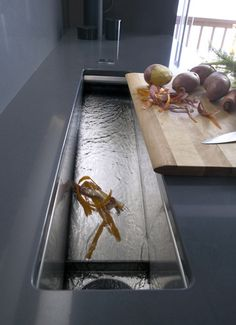 Prep sink with built-in waste disposal.