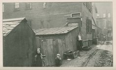 Alleys and street scenes in Chicago's immigrant neighborhoods around 1900.