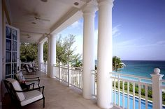Colonial style house on Caribbean coastline West Indies Style, Colonial Style Homes, Bahamas, Tropical Style, Paradise Island, Facade, Pergola, Outdoor Structures, Architecture